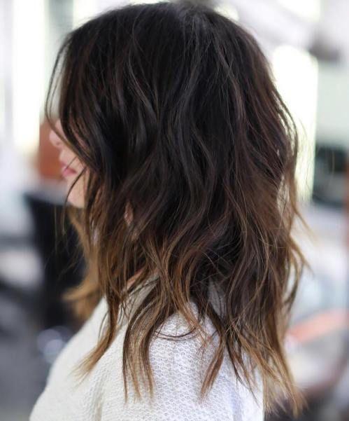 como dar volumen al pelo largo